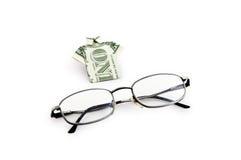 Un dollaro e vetri immagini stock
