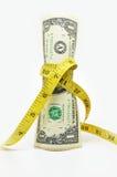 Un dollars d'argent des USA dans la bande de mesure Images stock