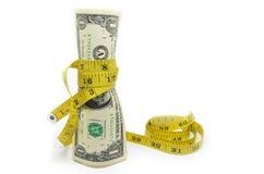 Un dollars d'argent des USA dans la bande de mesure Image stock