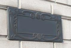 Un doorplate sulla parete nello stile d'annata Fotografia Stock