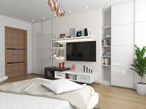 Un dormitorio con vistas a la TV Fotos de archivo libres de regalías