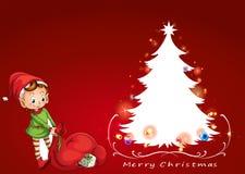 Un duende al lado del árbol de navidad Imagen de archivo libre de regalías