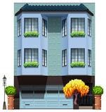 Un edificio con las plantas decorativas Foto de archivo