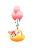 Un ejemplo hermoso de un vuelo del bebé en una cesta con los globos Imagen de archivo