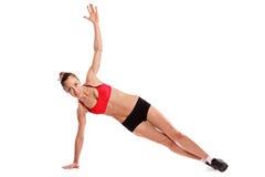 Un ejercicio femenino joven foto de archivo