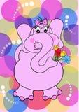 Un elefante con il fiore Immagini Stock