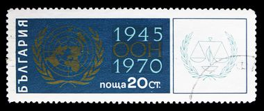 UN Emblem, Symbol of Peace, Progress and Justice, 25 Years United Nations serie, circa 1970. MOSCOW, RUSSIA - SEPTEMBER 15, 2018: A stamp printed in Bulgaria royalty free stock photography