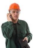 Empresario en el teléfono en el fondo blanco Foto de archivo libre de regalías