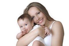 Un enfant avec sa mère Photos stock
