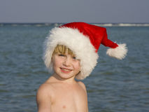 Un enfant sur la plage Photos libres de droits