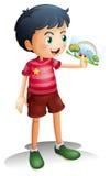 Un enfant tenant une image Photographie stock