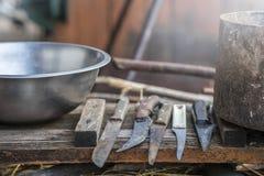 Un ensemble de boucher de couteaux Image stock