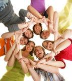 Un equipo de adolescentes felices en blanco Imagen de archivo
