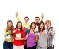 Un equipo de adolescentes jovenes que se unen Imágenes de archivo libres de regalías