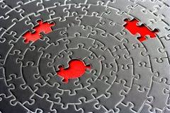 Un estratto di tre parti mancanti in un jigsaw Fotografia Stock Libera da Diritti