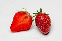Un et demi fraises Images libres de droits