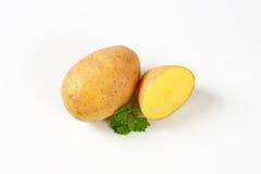 Un et demi pommes de terre Image libre de droits