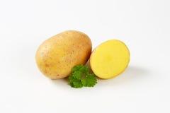 Un et demi pommes de terre Photographie stock