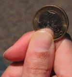 Un euro por favor? fotografía de archivo