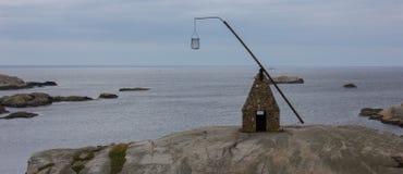 Un faro all'estremità del mondo in Nøtterøy, Norvegia fotografia stock libera da diritti