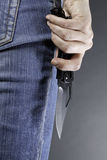 Un femme avec un couteau Photographie stock libre de droits