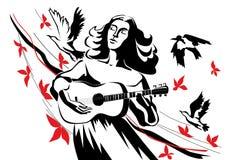 Un femme avec une guitare Photos stock