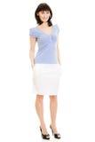 Un femme dans une chemise et une jupe bleues de blanc images libres de droits