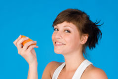 Un femme et une orange Photos libres de droits