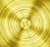 Un fer d'or en métal avec le fond circulaire de texture photographie stock