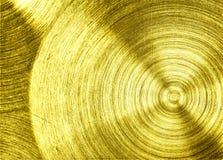 Un fer d'or en métal avec le fond circulaire de texture photos libres de droits