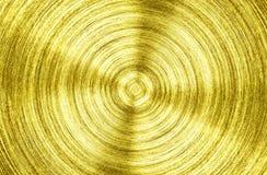 Un fer d'or en métal avec le fond circulaire de texture images libres de droits