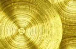 Un fer d'or en métal avec le fond circulaire de texture photo stock