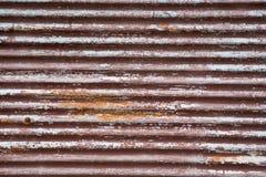 Un fer ondulé rouillé Photo stock