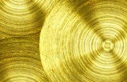 Un ferro dell'oro del metallo con il fondo circolare di struttura fotografie stock