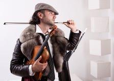 Un fiddler con il suo strumento fotografia stock