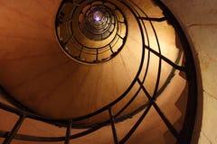 Un flash en la tapa de la escalera espiral Foto de archivo libre de regalías