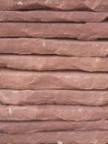 Un fond empilé de texture de mur en pierre Photographie stock libre de droits