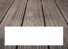 Un fond en bois de grain avec un boîtier blanc pour le texte supplémentaire Photo stock