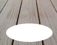 Un fond en bois de grain avec un ovale noir pour le texte supplémentaire Images stock