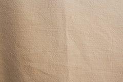 Un fondo amarillo la textura del fnd del paño imágenes de archivo libres de regalías