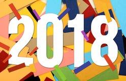 un fondo da 2018 nuovi anni con le carte variopinte Fotografia Stock