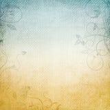 Un fondo de papel en amarillento y azul Fotos de archivo