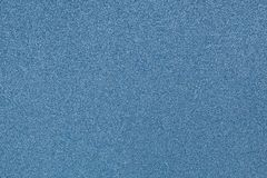 Un fondo decorativo reluciente del papel azul fotos de archivo
