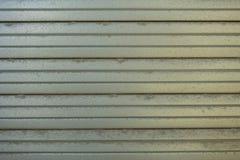 Un fondo dei ciechi di un colore grigio fotografia stock libera da diritti