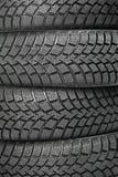 Un fondo dell'inverno della ruota di automobile quattro Fotografia Stock