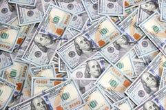 Un fondo di cento banconote in dollari di nuovo campione Fotografia Stock Libera da Diritti