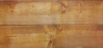 Un fondo di legno di bello colore marrone Fotografia Stock