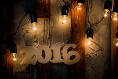 un fondo di legno di 2016 di anno Natali di numero Fotografia Stock