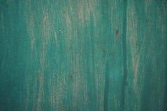 Un fondo verde del metal con diversos divorcios y sombras en él fotos de archivo