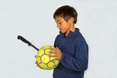Un football perforé Photo stock